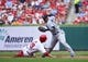 Sep 15, 2013; St. Louis, MO, USA; St. Louis Cardinals center fielder Jon Jay (19) prevents Seattle Mariners shortstop Carlos Triunfel (1) from turning a double play at Busch Stadium. Mandatory Credit: Scott Rovak-USA TODAY Sports