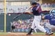 Sep 15, 2013; Minneapolis, MN, USA; The Minnesota Twins outfielder Chris Parmelee (27) hits a single in the seventh inning against the Tampa Bay Rays at Target Field. Mandatory Credit: Brad Rempel-USA TODAY Sports