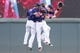 Sep 15, 2013; Minneapolis, MN, USA; The Minnesota Twins outfielder Darin Mastroianni (19), outfielder Alex Presley (1), and catcher Chris Herrmann (12) celebrate their 6-4 win against the Tampa Bay Rays in the ninth inning at Target Field. Mandatory Credit: Brad Rempel-USA TODAY Sports