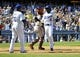 September 15, 2013; Los Angeles, CA, USA; Los Angeles Dodgers relief pitcher Edinson Volquez (30) and shortstop Dee Gordon (9) both celebrate after scoring runs during the fifth inning against the San Francisco Giants at Dodger Stadium. Mandatory Credit: Gary A. Vasquez-USA TODAY Sports