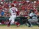 Sep 15, 2013; St. Louis, MO, USA; St. Louis Cardinals shortstop Daniel Descalso (33) hits an rbi single against the Seattle Mariners during the fourth inning at Busch Stadium. The Cardinals defeated the Mariners 12-2. Mandatory Credit: Scott Rovak-USA TODAY Sports