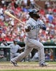 Sep 15, 2013; St. Louis, MO, USA; Seattle Mariners right fielder Abraham Almonte (36) hits a sacrifice fly against the St. Louis Cardinals at Busch Stadium. The Cardinals defeated the Mariners 12-2. Mandatory Credit: Scott Rovak-USA TODAY Sports