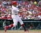 Sep 15, 2013; St. Louis, MO, USA; St. Louis Cardinals right fielder Carlos Beltran (3) hits a 2 run single against the Seattle Mariners during the seventh inning at Busch Stadium. The Cardinals defeated the Mariners 12-2. Mandatory Credit: Scott Rovak-USA TODAY Sports