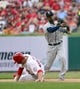 Sep 15, 2013; St. Louis, MO, USA; Seattle Mariners shortstop Carlos Triunfel (1) turns a double play over St. Louis Cardinals third baseman David Freese (23) at Busch Stadium. The Cardinals defeated the Mariners 12-2. Mandatory Credit: Scott Rovak-USA TODAY Sports