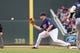Sep 15, 2013; Minneapolis, MN, USA; The Minnesota Twins outfielder Chris Parmelee (27) catches the ball at first in the sixth inning against the Tampa Bay Rays at Target Field. Twins win 6-4. Mandatory Credit: Brad Rempel-USA TODAY Sports