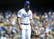 September 15, 2013; Los Angeles, CA, USA; Los Angeles Dodgers relief pitcher Brian Wilson (00) returns to the dugout after pitching the seventh inning against the San Francisco Giants at Dodger Stadium. Mandatory Credit: Gary A. Vasquez-USA TODAY Sports