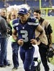 Sep 15, 2013; Seattle, WA, USA; Seattle Seahawks quarterback Russell Wilson (3) jogs off the field after the game against the San Francisco 49ers at CenturyLink Field. Seattle defeated San Francisco 29-3. Mandatory Credit: Steven Bisig-USA TODAY Sports