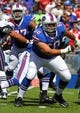Sep 8, 2013; Orchard Park, NY, USA; Buffalo Bills guard Kraig Urbik (60) against the New England Patriots at Ralph Wilson Stadium.  Mandatory Credit: Timothy T. Ludwig-USA TODAY Sports