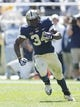 Sep 14, 2013; Pittsburgh, PA, USA; Pittsburgh Panthers running back Isaac Bennett (34) carries the ball against the New Mexico Lobos during the second quarter at Heinz Field. The Pittsburgh Panthers won 49-27. Mandatory Credit: Charles LeClaire-USA TODAY Sports
