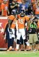 Sep 5, 2013; Denver, CO, USA; Denver Broncos wide receiver Demaryius Thomas (88) reacts to his touchdown reception with tight end Virgil Green (85) in the fourth quarter of the game against the Baltimore Ravens at Sports Authority Field at Mile High. Mandatory Credit: Ron Chenoy-USA TODAY Sports