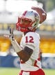 Sep 14, 2013; Pittsburgh, PA, USA; New Mexico Lobos quarterback Clayton Mitchem (12) warms up on the field before playing the Pittsburgh Panthers at Heinz Field. The Pittsburgh Panthers won 49-27. Mandatory Credit: Charles LeClaire-USA TODAY Sports