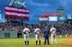 Sep 13, 2013; Boston, MA, USA; New York Yankees third baseman Alex Rodriguez (13) center fielder Curtis Granderson (14) and first baseman Lyle Overbay (55) pay tribute to the national anthem prior to a game against the Boston Red Sox at Fenway Park. Mandatory Credit: Bob DeChiara-USA TODAY Sports