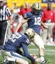 Sep 14, 2013; Pittsburgh, PA, USA; Pittsburgh Panthers kicker Chris Blewitt (12) kicks an extra point against the New Mexico Lobos during the first quarter at Heinz Field. The Pittsburgh Panthers won 49-27. Mandatory Credit: Charles LeClaire-USA TODAY Sports