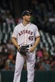 Sep 16, 2013; Houston, TX, USA; Houston Astros starting pitcher Erik Bedard (45) reacts after a pitch during the fourth inning against the Cincinnati Reds at Minute Maid Park. Mandatory Credit: Troy Taormina-USA TODAY Sports