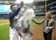 Sep 16, 2013; Milwaukee, WI, USA;  Milwaukee Brewers left fielder Caleb Gindl (center) is doused with powder by center fielder Carlos Gomez (left) during an interview with reporter Sophia Minnaert after the Brewers beat the Chicago Cubs 6-1 at Miller Park. Gindl had 3 hits, scored 3 runs and had 3 RBIs.  Mandatory Credit: Benny Sieu-USA TODAY Sports