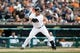 Sep 15, 2013; Detroit, MI, USA; Detroit Tigers second baseman Omar Infante (4) at bat against the Kansas City Royals at Comerica Park. Mandatory Credit: Rick Osentoski-USA TODAY Sports
