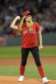 Sep 15, 2013; Boston, MA, USA; Boston marathon victim Victoria McGrath throws out the first pitch before the start of a game between the Boston Red Sox and New York Yankees at Fenway Park. Mandatory Credit: Bob DeChiara-USA TODAY Sports