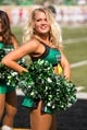 Sep 14, 2013; Denton, TX, USA; A North Texas Mean Green cheerleader performs during the game between the Mean Green and the Ball State Cardinals at Apogee Stadium. The Mean Green defeated the Cardinals 34-27. Mandatory Credit: Jerome Miron-USA TODAY Sports