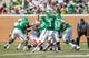 Sep 14, 2013; Denton, TX, USA; North Texas Mean Green quarterback Derek Thompson (7) passes against the against the Ball State Cardinals during the game at Apogee Stadium. The Mean Green defeated the Cardinals 34-27. Mandatory Credit: Jerome Miron-USA TODAY Sports