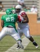 Sep 14, 2013; Denton, TX, USA; North Texas Mean Green offensive linesman Cyril Lemon (62) blocks North Texas Mean Green linebacker LaJaylin Smith (92) during the game at Apogee Stadium. The Mean Green defeated the Cardinals 34-27. Mandatory Credit: Jerome Miron-USA TODAY Sports