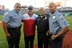 Sep 17, 2013; Washington, DC, USA; Washington Nationals general manager Mike Rizzo poses for a photo with Washington DC police  before the game against the Atlanta Braves at Nationals Park. Mandatory Credit: Brad Mills-USA TODAY Sports