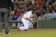 Sep 17, 2013; Boston, MA, USA; Boston Red Sox second baseman Dustin Pedroia (15) fields a ground ball during the second inning against the Baltimore Orioles at Fenway Park. Mandatory Credit: Bob DeChiara-USA TODAY Sports