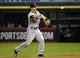 Sep 17, 2013; Chicago, IL, USA; Minnesota Twins second baseman Brian Dozier (2) makes a throw to first base against the Chicago White Sox during the first inning at U.S Cellular Field. Mandatory Credit: Mike DiNovo-USA TODAY Sports