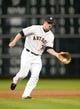 Sep 17, 2013; Houston, TX, USA; Houston Astros third baseman Matt Dominguez (30) fields a ground ball against the Cincinnati Reds during the fourth inning at Minute Maid Park. Mandatory Credit: Thomas Campbell-USA TODAY Sports