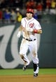 Sep 17, 2013; Washington, DC, USA; Washington Nationals third baseman Ryan Zimmerman (11) rounds the bases after hitting a solo home run during the eighth inning against the Atlanta Braves at Nationals Park. The Nationals won 4 - 0. Mandatory Credit: Brad Mills-USA TODAY Sports