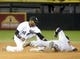 Sep 17, 2013; Chicago, IL, USA; Chicago White Sox shortstop Alexei Ramirez (10) makes the tag on Minnesota Twins second baseman Brian Dozier (2) during the fourth inning at U.S Cellular Field. Mandatory Credit: Mike DiNovo-USA TODAY Sports
