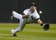 Sep 17, 2013; Chicago, IL, USA; Chicago White Sox center fielder Jordan Danks (20) makes a diving catch against the Minnesota Twins during the fourth inning at U.S Cellular Field. Mandatory Credit: Mike DiNovo-USA TODAY Sports