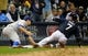Sep 17, 2013; Milwaukee, WI, USA;   Milwaukee Brewers right fielder Norichika Aoki slides into third base with a triple before tag by Chicago Cubs third baseman Donnie Murphy in the sixth inning at Miller Park. Mandatory Credit: Benny Sieu-USA TODAY Sports