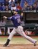 Sep 17, 2013; St. Petersburg, FL, USA; Texas Rangers first baseman Mitch Moreland (18) doubles during the seventh inning against the Tampa Bay Rays at Tropicana Field. The Rangers won 7-1. Mandatory Credit: Kim Klement-USA TODAY Sports