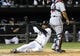 Sep 17, 2013; Chicago, IL, USA; Chicago White Sox center fielder Alejandro De Aza (30) slides safely into home plate in front of Minnesota Twins catcher Josmil Pinto (43) during the sixth inning at U.S Cellular Field. Mandatory Credit: Mike DiNovo-USA TODAY Sports