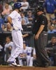 Sep 17, 2013; Kansas City, MO, USA; Kansas City Royals first baseman Eric Hosmer (35) talks to home plate umpire Fieldin Culbreth (25) after being called out against the Cleveland Indians in the ninth inning at Kauffman Stadium. The Indians won 5-3. Mandatory Credit: John Rieger-USA TODAY Sports