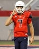 Sep 14, 2013; Tucson, AZ, USA; Arizona Wildcats quarterback B.J. Denker (7) practices during warm ups before the first quarter against the Texas-San Antonio Roadrunners at Arizona Stadium. The Wildcats defeated the Roadrunners 38-13. Mandatory Credit: Casey Sapio-USA TODAY Sports