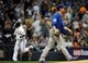 Sep 18, 2013; Milwaukee, WI, USA;   Chicago Cubs pitcher Chris Rusin (right) watches Milwaukee Brewers first baseman Sean Halton (left) run the bases after hitting a grand slam home run in the first inning at Miller Park. Mandatory Credit: Benny Sieu-USA TODAY Sports