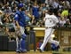 Sep 18, 2013; Milwaukee, WI, USA;   Milwaukee Brewers shortstop Jean Segura (right) scores past Chicago Cubs catcher Dioner Navarro (left) but had to leave the game with a hamstring injury in the first inning at Miller Park. Mandatory Credit: Benny Sieu-USA TODAY Sports