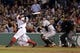 Sep 18, 2013; Boston, MA, USA; Boston Red Sox first baseman Mike Napoli (12) hits a home run against the Baltimore Orioles in the sixth inning at Fenway Park. Mandatory Credit: David Butler II-USA TODAY Sports