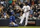 Sep 18, 2013; Milwaukee, WI, USA;   Milwaukee Brewers left fielder Khris Davis (right) scores in front of Chicago Cubs catcher Dioner Navarro (left) after hitting a solo home run in the fourth inning at Miller Park. Mandatory Credit: Benny Sieu-USA TODAY Sports