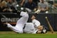 Sep 18, 2013; Milwaukee, WI, USA;   Milwaukee Brewers right fielder Norichika Aoki grimaces on the ground after he was hit by a pitch from Chicago Cubs' Alberto Cabrera (not pictured) in the fifth inning at Miller Park. Mandatory Credit: Benny Sieu-USA TODAY Sports
