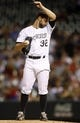 Sep 18, 2013; Denver, CO, USA; Colorado Rockies pitcher Tyler Chatwood (32) reacts during the first inning against the St. Louis Cardinals at Coors Field. Mandatory Credit: Chris Humphreys-USA TODAY Sports