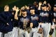 Sep 18, 2013; Washington, DC, USA; Atlanta Braves second baseman Dan Uggla (26) high fives teammates after beating the Washington Nationals 5-2 at Nationals Park. Mandatory Credit: Evan Habeeb-USA TODAY Sports