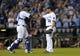 Sep 18, 2013; Kansas City, MO, USA; Kansas City Royals relief pitcher Greg Holland (56) is congratulated by catcher Salvador Perez (13) after the game against the Cleveland Indians at Kauffman Stadium. The Royals won 7-2. Mandatory Credit: Denny Medley-USA TODAY Sports
