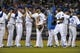 Sep 18, 2013; Kansas City, MO, USA; Kansas City Royals left fielder Alex Gordon (4) and center fielder Lorenzo Cain (6) are congratulated by teammates after the game against the Cleveland Indians at Kauffman Stadium. The Royals won 7-2. Mandatory Credit: Denny Medley-USA TODAY Sports