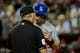 Sep 18, 2013; Phoenix, AZ, USA; Los Angeles Dodgers third baseman Michael Young (10) argues with MLB umpire Jim Joyce after being called out at home plate during the sixth inning against the Arizona Diamondbacks at Chase Field. Mandatory Credit: Matt Kartozian-USA TODAY Sports