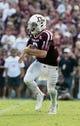 Sep 14, 2013; College Station, TX, USA; Texas A&M Aggies  quarterback Johnny Manziel (2) scrambles against the Alabama Crimson Tide at Kyle Field. Mandatory Credit: Matthew Emmons-USA TODAY Sports