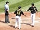 Sep 19, 2013; Pittsburgh, PA, USA; Pittsburgh Pirates catcher Tony Sanchez (59) and shortstop Jordy Mercer (10) celebrate at home plate after scoring runs against the San Diego Padres during the fourth inning at PNC Park. Mandatory Credit: Charles LeClaire-USA TODAY Sports