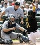 Sep 19, 2013; Pittsburgh, PA, USA; San Diego Padres catcher Nick Hundley (left) tags out Pittsburgh Pirates right fielder Jose Tabata (31) at home plate as umpire Dan Bellino observes during the sixth inning at PNC Park. Mandatory Credit: Charles LeClaire-USA TODAY Sports