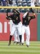 Sep 19, 2013; Pittsburgh, PA, USA; Pittsburgh Pirates outfielders  Felix Pie (26) and Andrew McCutchen (back) and Josh Harrison (5) celebrate after defeating the San Diego Padres at PNC Park. The Pittsburgh Pirates won 10-1. Mandatory Credit: Charles LeClaire-USA TODAY Sports